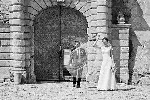 Wedding couple near door of old vint