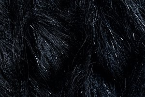 top view of furry black textile as b