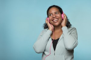 Pretty black woman with headphone