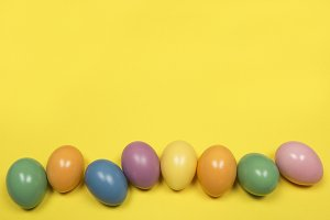 Pastel easter eggs on yellow