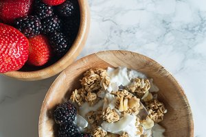Bowls of berries and cereal