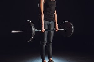 serious sportswoman exercising with