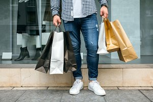 Low section of man shopping