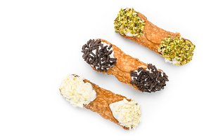 Three cannoli pastries