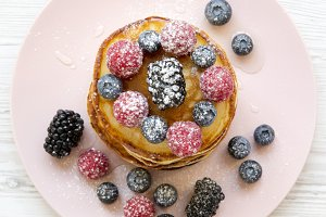 Pancakes with berries, honey