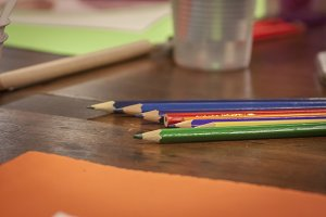 Colorful wooden pencils on the table