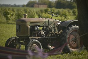 Old rusty and ruined agricultural tr