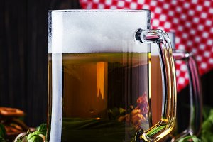 Light german beer poured into big gl