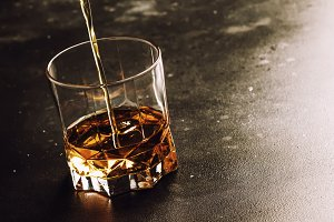 Whiskey Pour In Glass, Dark Backgrou
