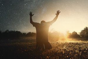 Grateful man praying to God
