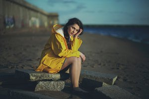 Riverside Girl in Yellow Raincoat