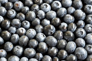 Ripe blueberries on dark background
