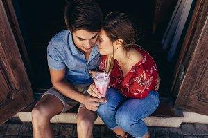 Romantic tourist couple sitting