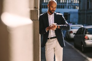 Young businessman checking time
