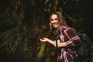 Cheerful woman enjoying a hike
