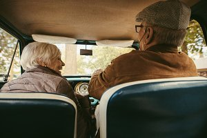 Old couple driving a car