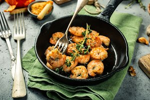 Shrimps roasted on frying cast iron