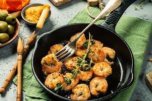 Shrimps roasted on frying cast iron