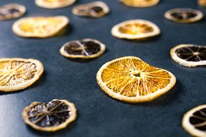 Dried sliced lemon and orange on dar