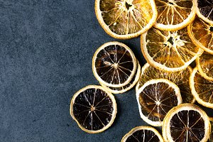Sliced dried lemon and orange on dar