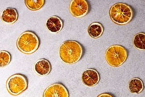 Dried sliced lemon and orange on whi