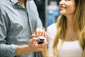 Smiling couple choosing a shaver in