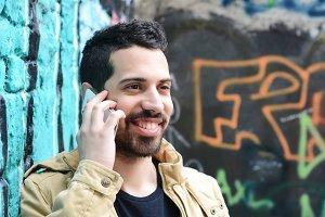 Latin man talking on the phone