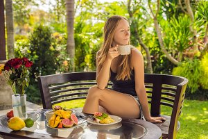 Woman eating breakfast on the