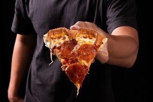 Pizza on human hand