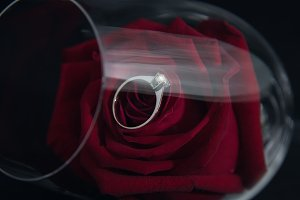 Wedding rings and roses in a glass o