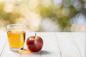 Fresh apple juice in the glass