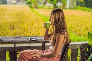 Young woman holding cup of matcha