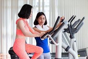 Asian women exercising