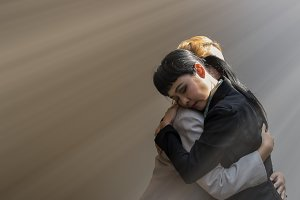 Women are embracing with sad emotion