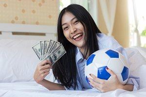 Asian woman holding money