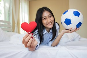 Woman is playing with a soccer ball