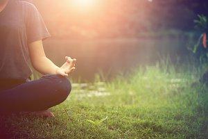 ํYoung woman doing yoga