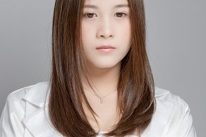 Asian woman on a gray background