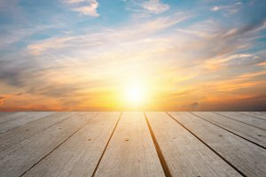 Top wood background in sunset sky