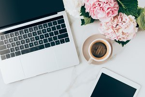 flat lay with coffee cup, laptop, di