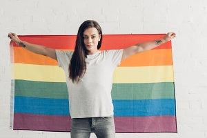 confident transgender man holding pr