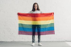 young transgender man holding pride