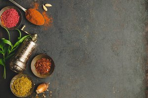 Herbs and spices on dark background