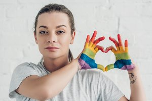 young transgender man making heart s