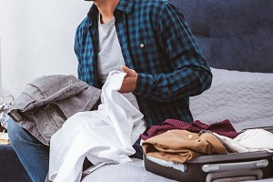 thoughtful man sitting with clothes
