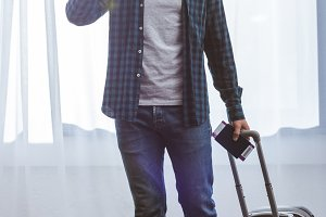 adult male traveler with passport ca