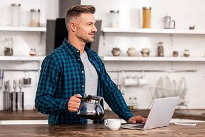 handsome smiling man holding coffee