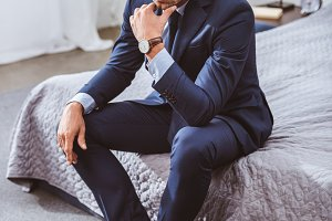 thoughtful man in suit and eyeglasse