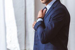 handsome man in suit wearing necktie