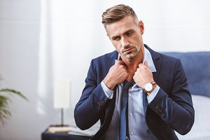 handsome man wearing necktie and loo